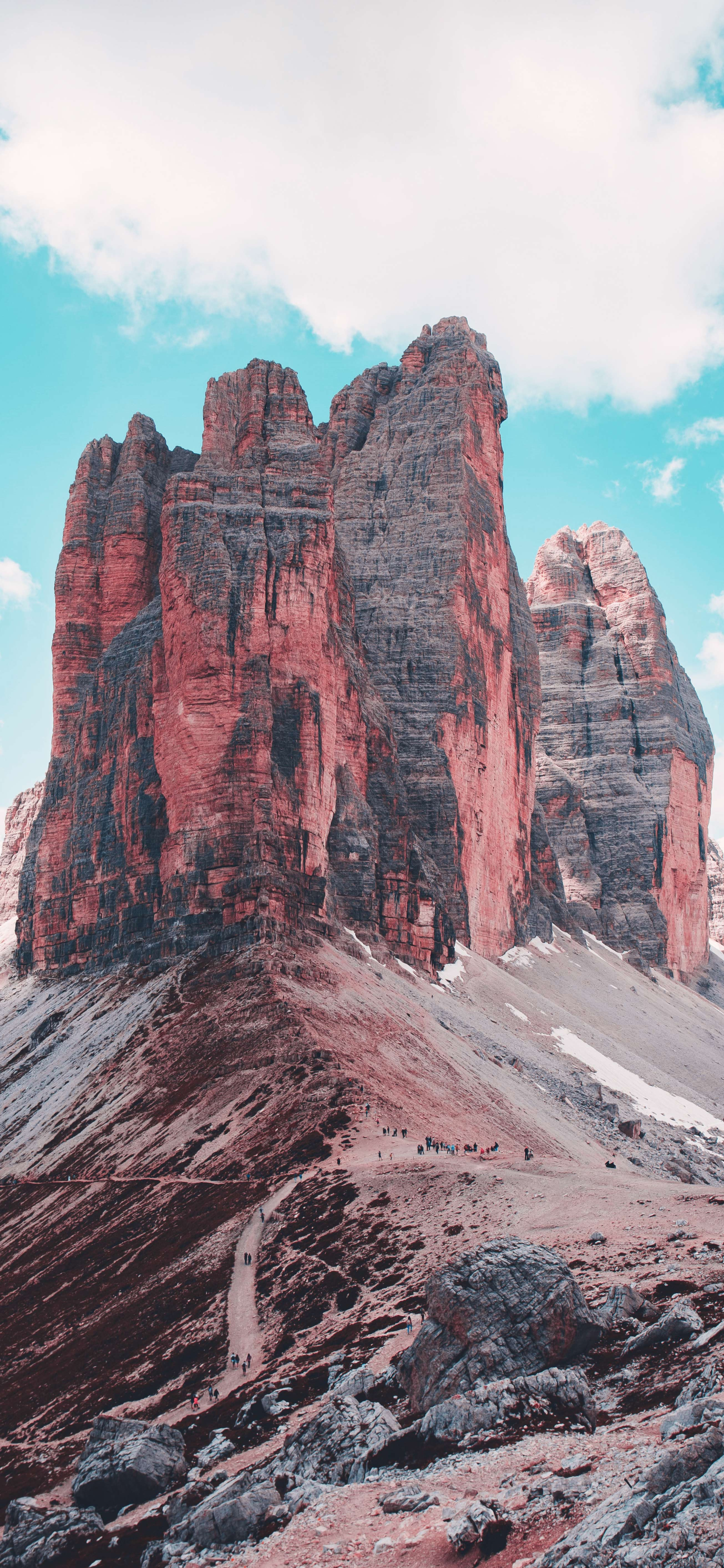 brown-rocky-mountain-under-blue-sky-wallpaper